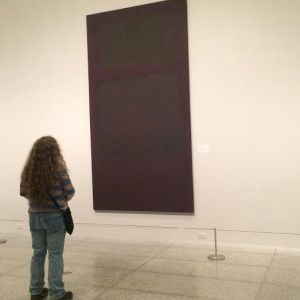 Chava looking at large canvas 3